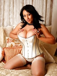 Danica Collins in classy corset playing with her toy