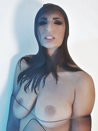 Paige Turnah is incased in this full body nylon suit and..