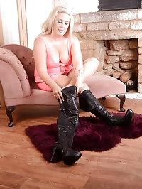 Curvy blonde puts on a sexy black pair of thigh high..