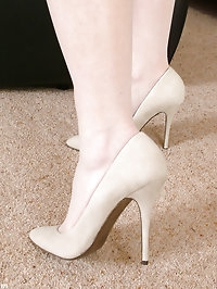 Alison looks gorgeous in her matching long creamy high heels