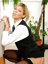 Beautiful Belle in secretary outfit with stockings