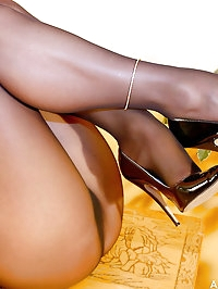 Astrid shows off her great legs in Wolford pantyhose