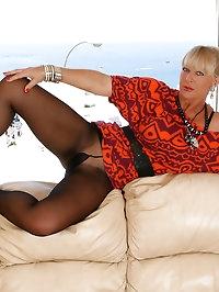 Astrid - Leggy blonde MILF tries on new shoes in sheer..