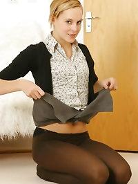 Gorgeous leggy Joceline in opaque pantyhose and miniskirt