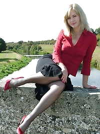 Sexy blonde with red high heels and gorgeous black nylons