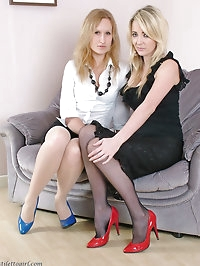 Two beautiful girls wearing multi coloured high heels