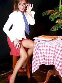 Nice-looking Roni sitting and showing her cute pantyhose