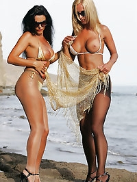 Two maids play in the beach