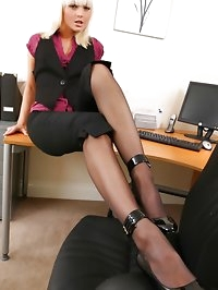 Blonde Sandra is wearing tight satin cropped trousers, and..