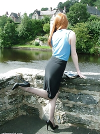 Cute redhead Miranda flashing her shiny stilettos and..