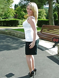 Sexy blonde tease outdoors with gorgeous high heels on
