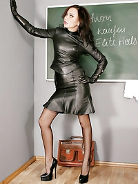 Sexy teacher Nadja dressed in leather, stockings and high..