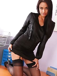 Saucy Sarah teases her way out of her tight black office..