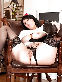 Busty business woman Raven flaunts her sultry milf body in..