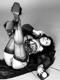 Danica Collins in corset and stockings in retro black and..