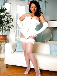 Danica Collins in white lace corset, stockings and satin..