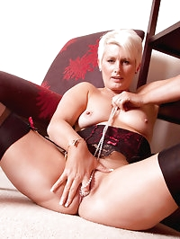 Blonde Anilos Sally Taylor stuffs her tight cougar pussy..