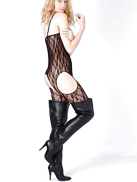 Kinky blonde wearing thigh high leather boots and a sexy..