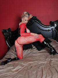A red lace body suit makes Becca look like a really fiesty..